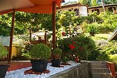 entrada e vista jardim tropical