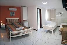Apto. quádruplo, composto por uma cama de casal e duas camas de solteiro.É uma das opções de apto.que pode receber até duas camas extras.