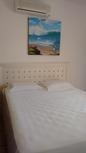 Suite 1 do apartamento térreo vista para o mar