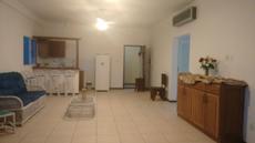 Sala e cozinha americana apartamento vista para o mar 2º andar