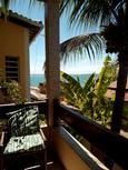 varanda apartamento vista lateral par o mar