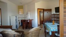 Sala e cozinha americana apartamento vista lateral para o mar 2º andar