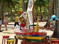 Lá, Papai Noel Chega de Barco