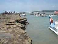 Travessia de lancha para a praia do Gunga